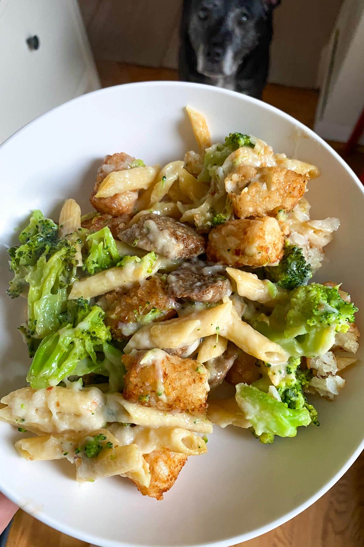 bowl of vegan mac and cheese with broccoli, Beyond Sausage, and tater tots