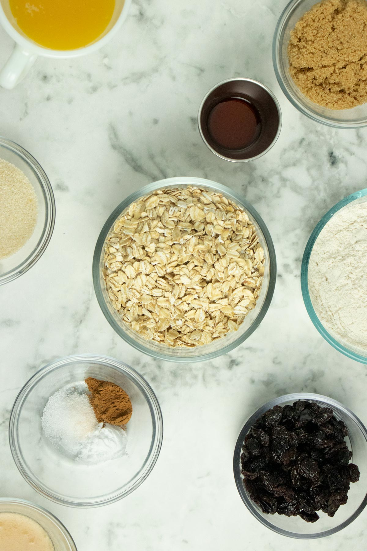 oatmeal raisin cookie ingredients on a marble tabletop