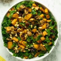butternut squash kale salad in a white bowl