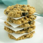 stack of vegan oatmeal raisin cookies on a white plate