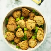 air fryer hush puppies in a bowl on a marble table