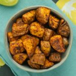 bowl of air fryer sweet potatoes on a blue napkin