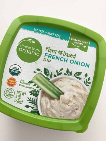 container of Simple Truth Plant-Based French Onion Dip on a white table