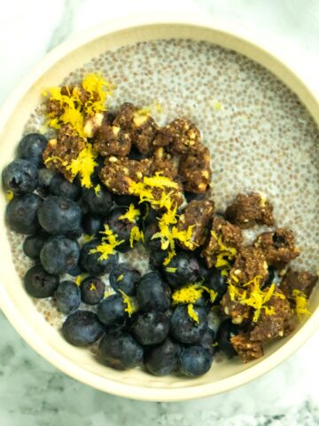 blueberry lemon chia breakfast bowl on a marble table