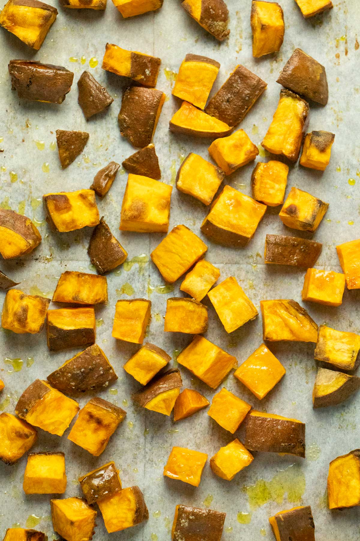 roasted sweet potato cubes on the baking sheet, fresh out of the oven