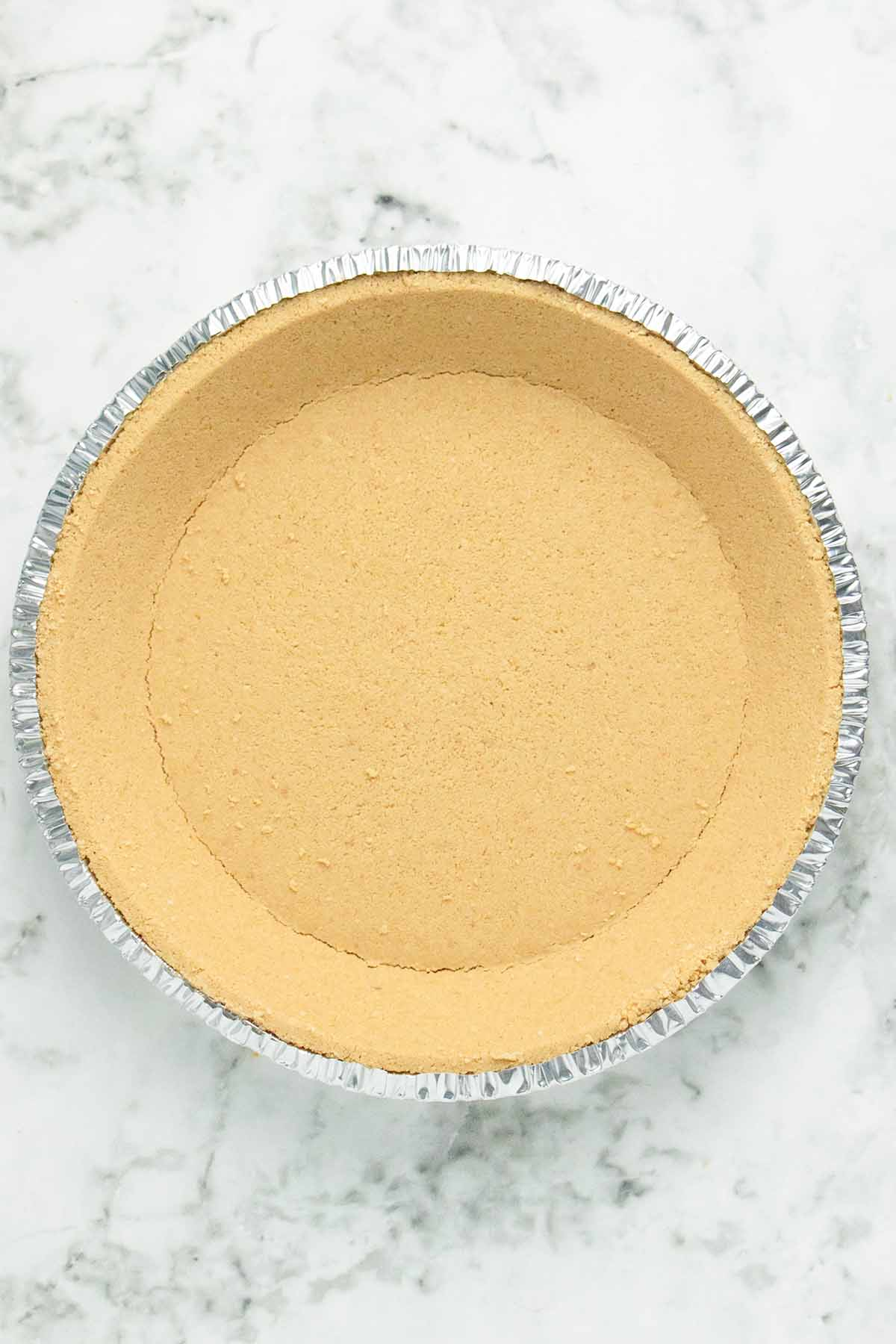 vegan graham cracker crust on a marble table