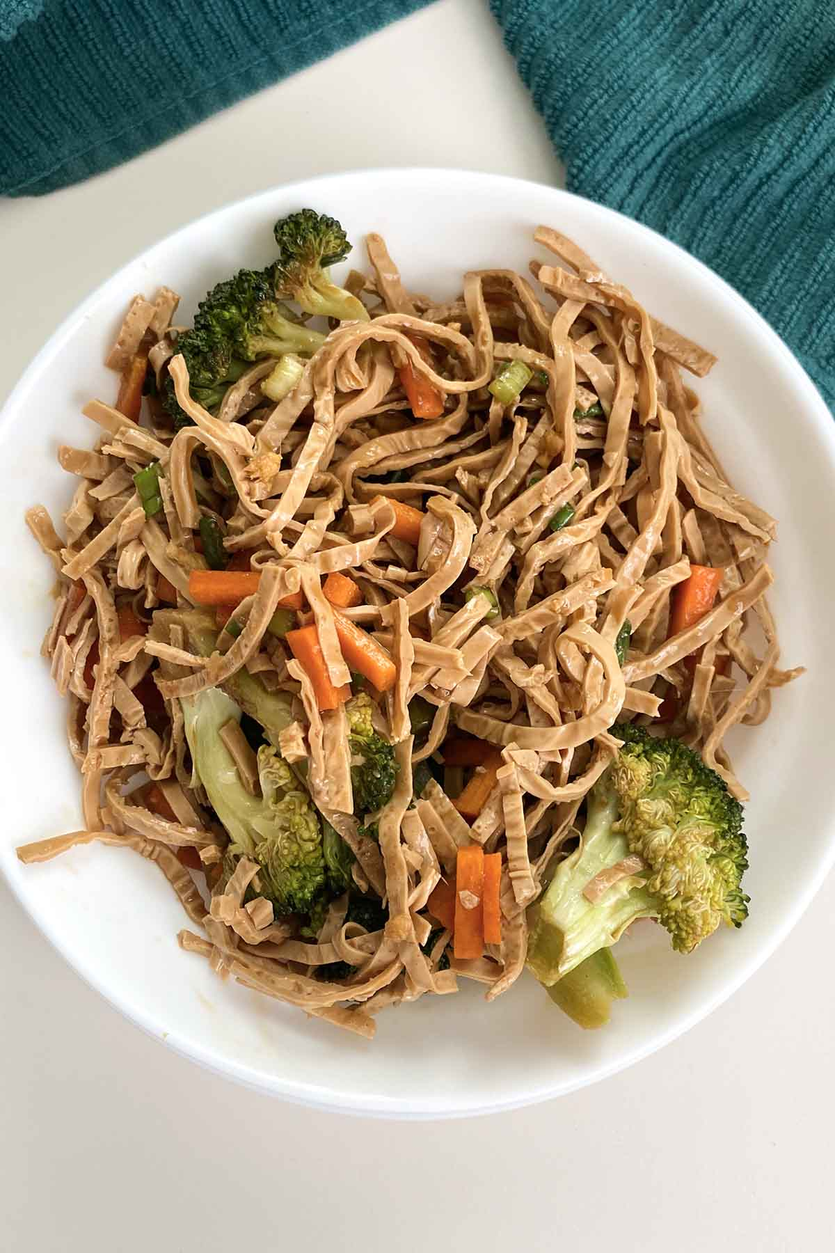 cold salad with tofu noodles, broccoli, carrots, and green onion