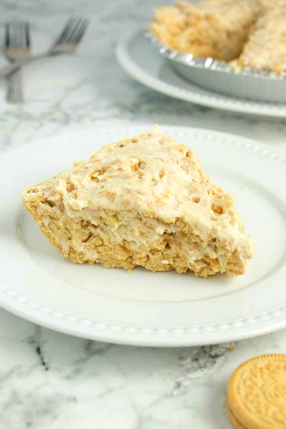 slice of vegan Golden Oreo pie on a white plate
