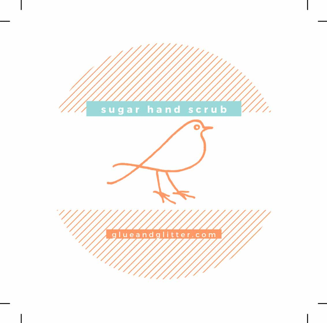"""label with bleed lines. Label is an orange, striped circle with text boxes that read """"sugar hand scrub"""" and """"glueandglitter.com"""""""