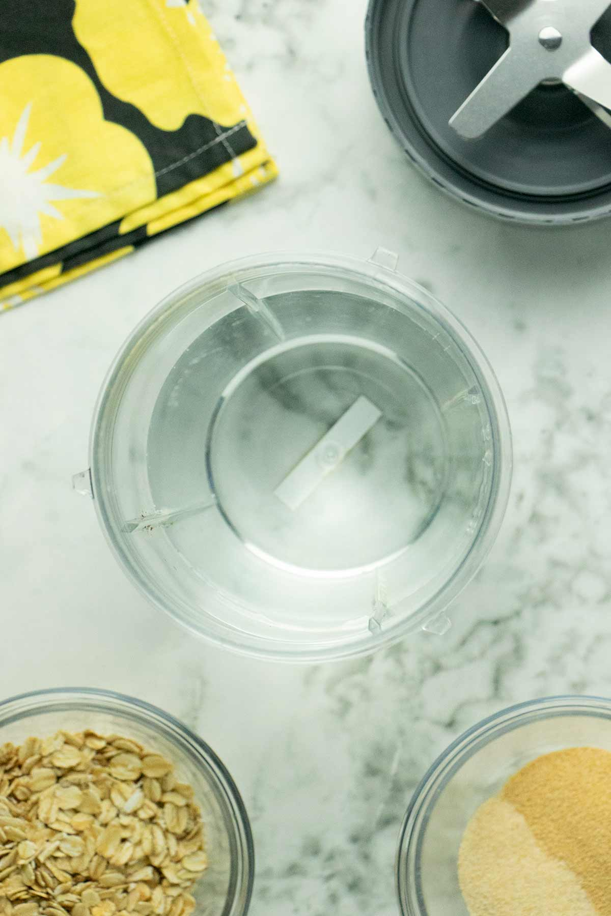 seasoned oat milk ingredients on a marble table