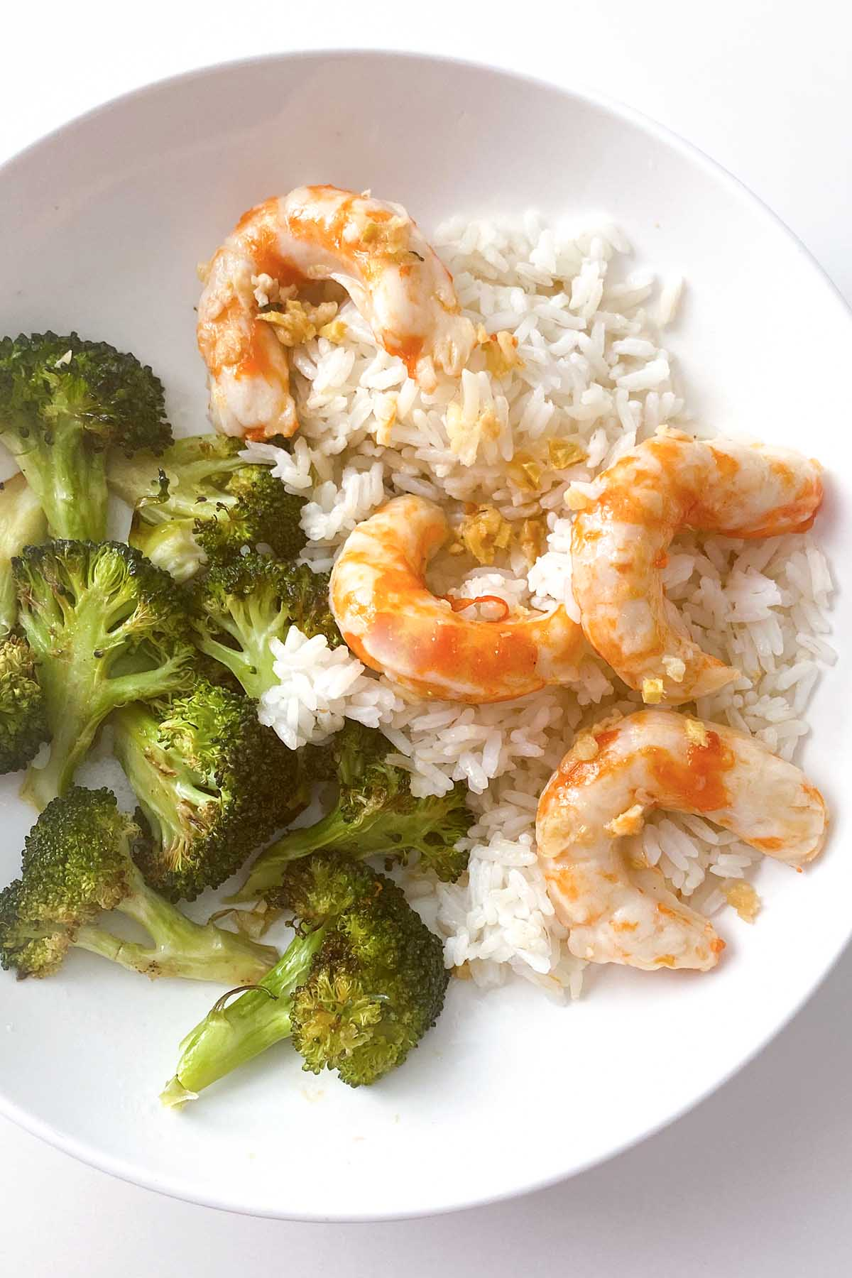 rice bowl with vegan shrimp and roasted broccoli