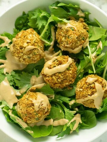 green salad topped with air fryer falafel
