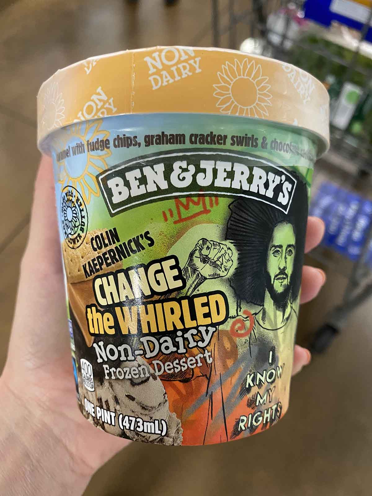 hand holding a pint of Ben & Jerry's Change the Whirled