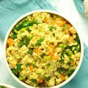 bowl of tofu fried rice on a blue napkin
