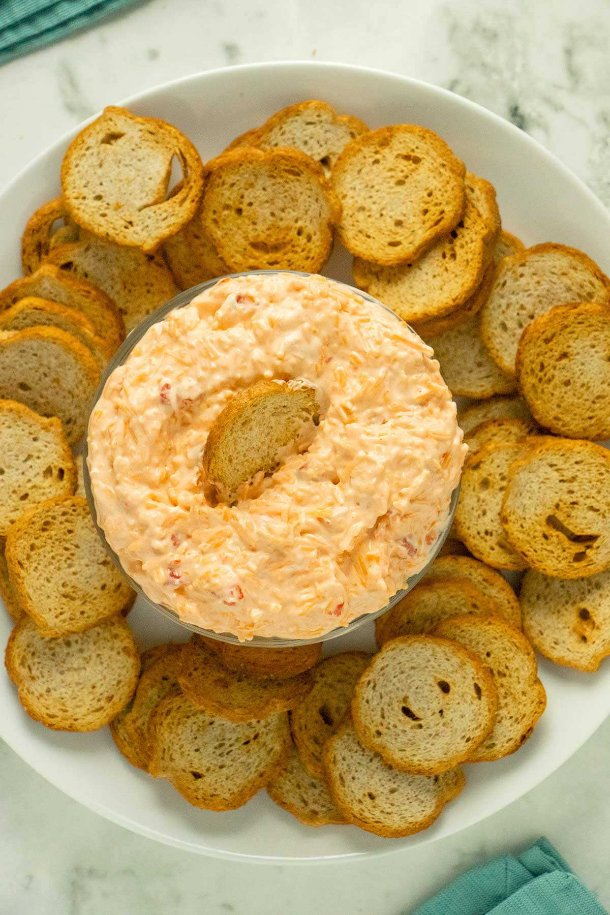 serving bowl of vegan pimento cheese with crackers