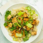 air fryer stir fry on a white plate with rice