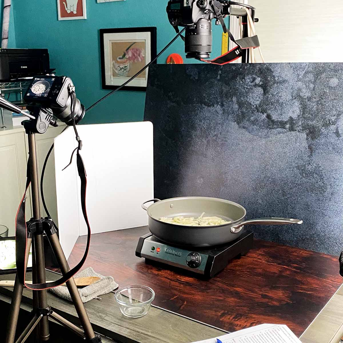 pan on a burner surrounded by recipe video production equipment