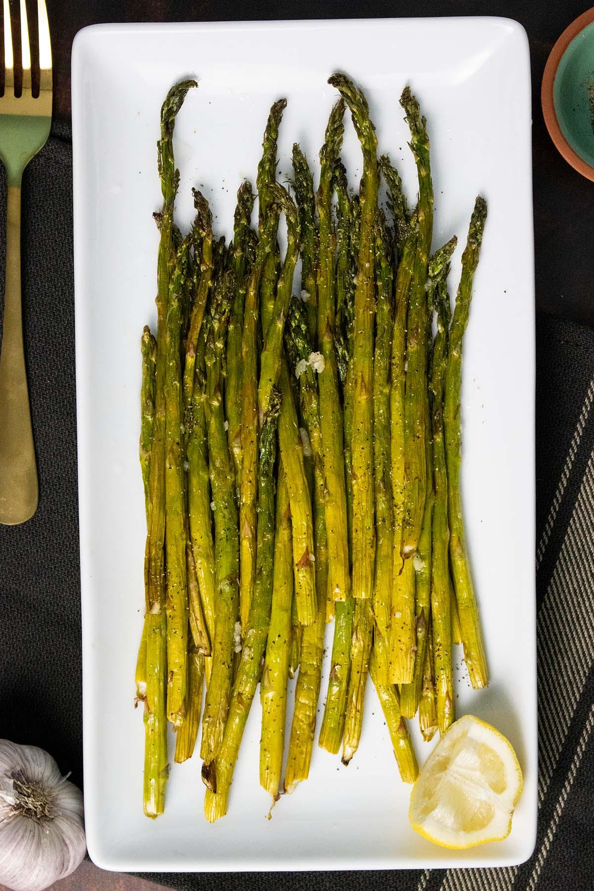 air fryer asparagus on a white serving plate