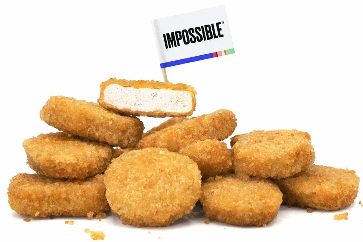 """pile of vegan chicken nuggets with a flag on top that reads, """"IMPOSSIBLE"""""""