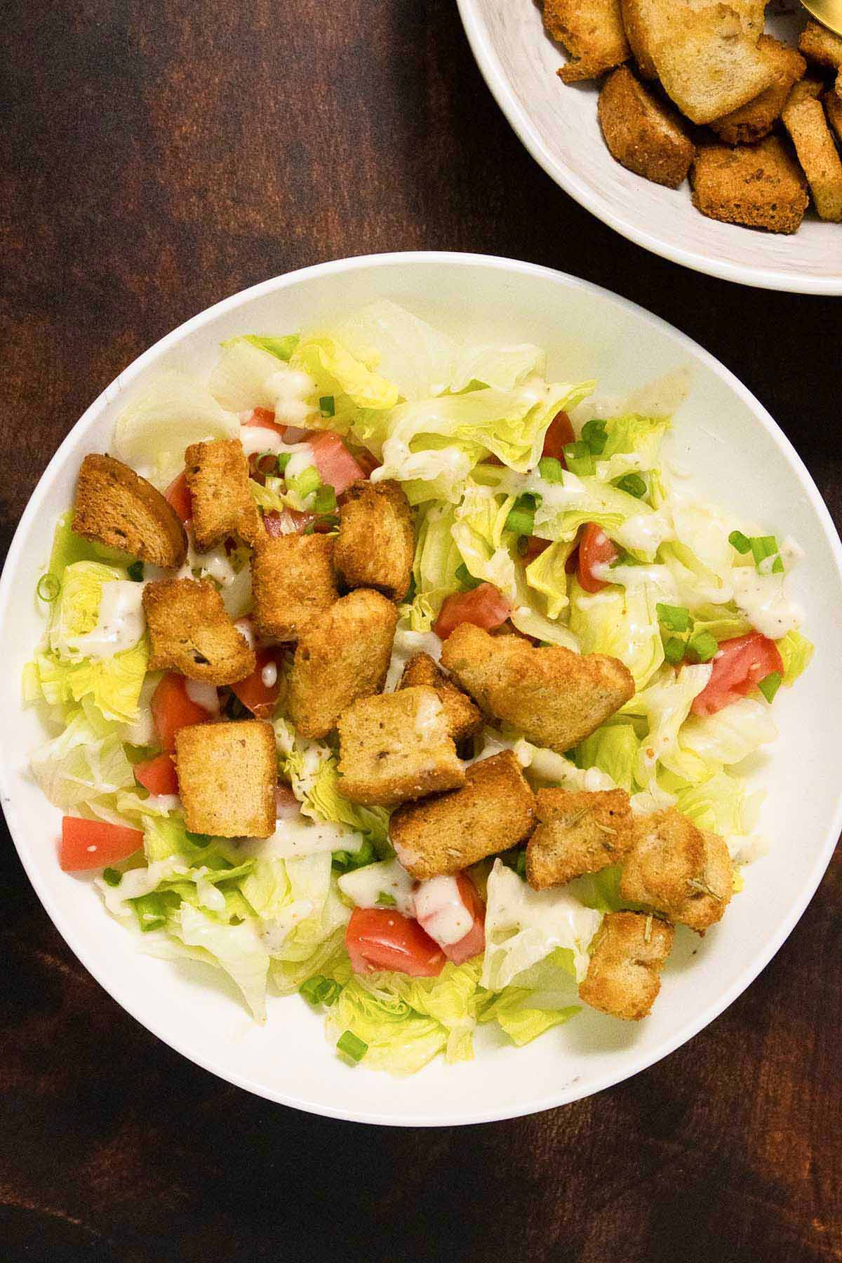 salad topped with creamy dressing and air fryer croutons
