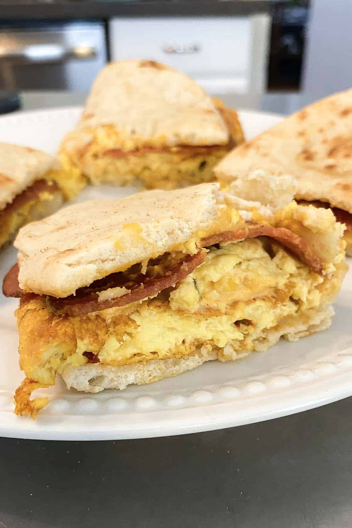 flatbread sandwich with vegan ham, egg, and cheese
