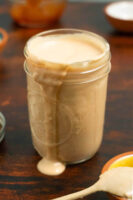 jar of vegan Russian dressing on a dark brown table